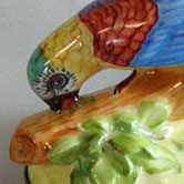 Parrot figurine and butterfly
