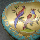 Pair of birds on gold
