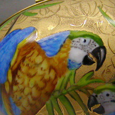 Parrot pair over gold
