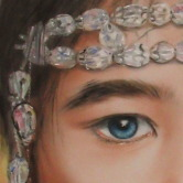 Portrait of a young girl wearing crystals